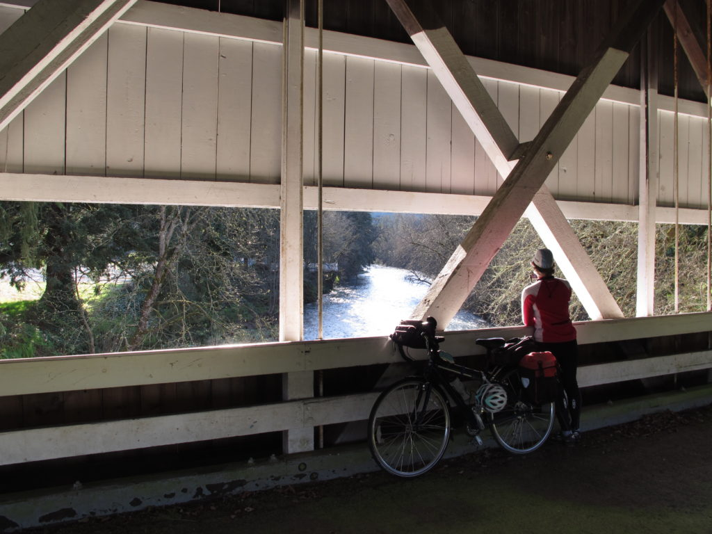 albany oregon visitors association cycling on covered bridge