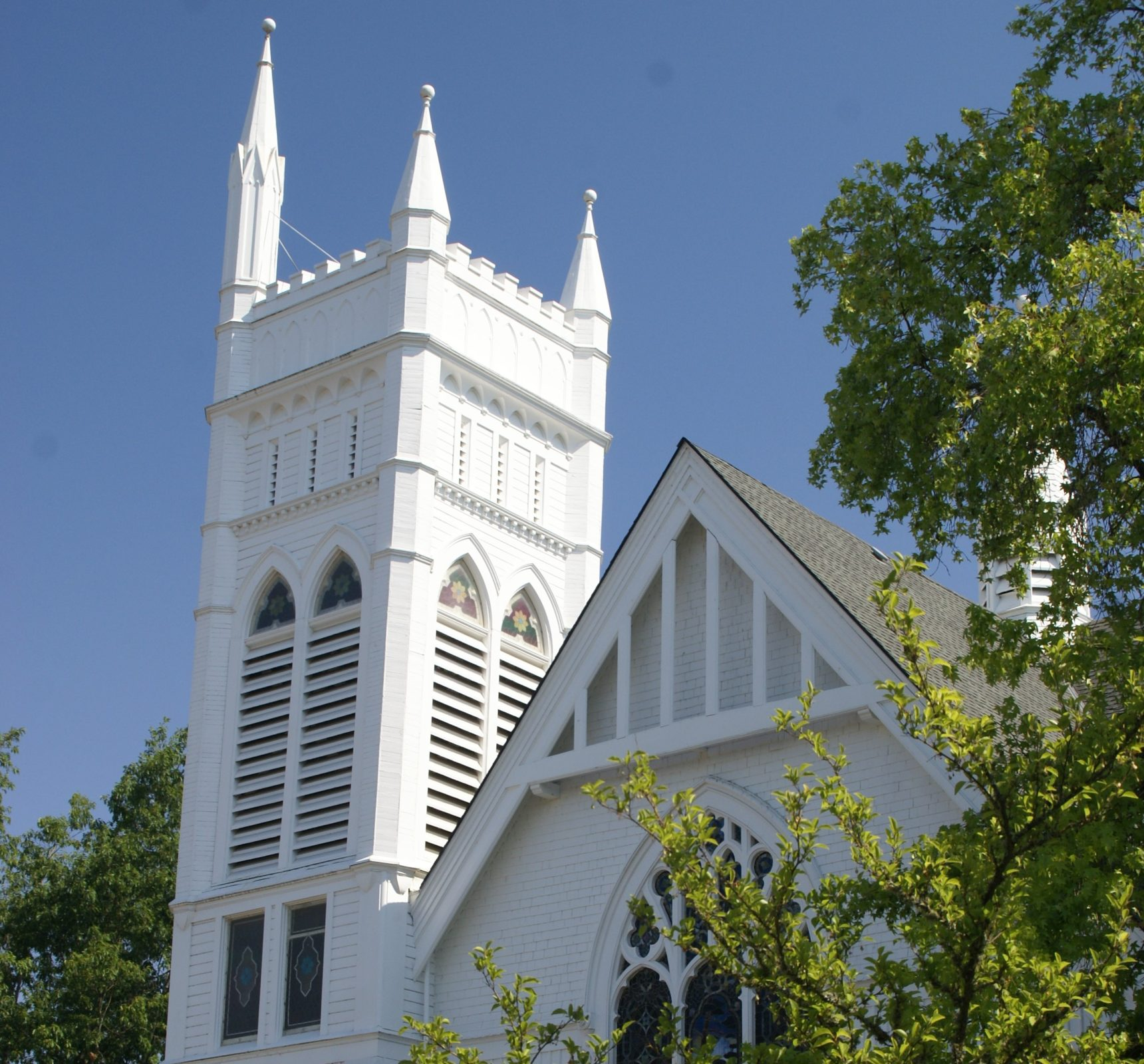 Photo of church with blue sky.