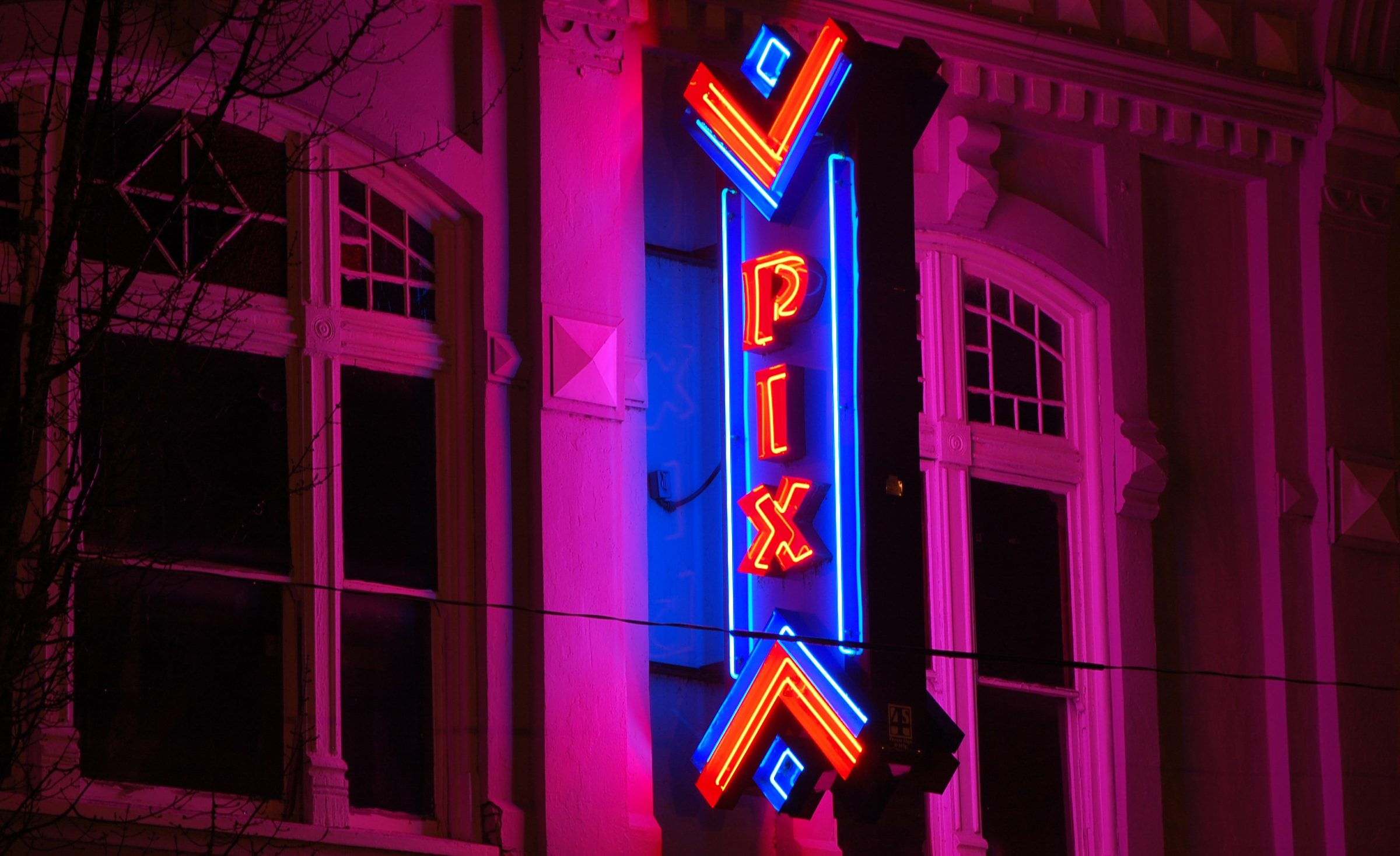 Photo of Pix Theater pink and purple neon light sign.