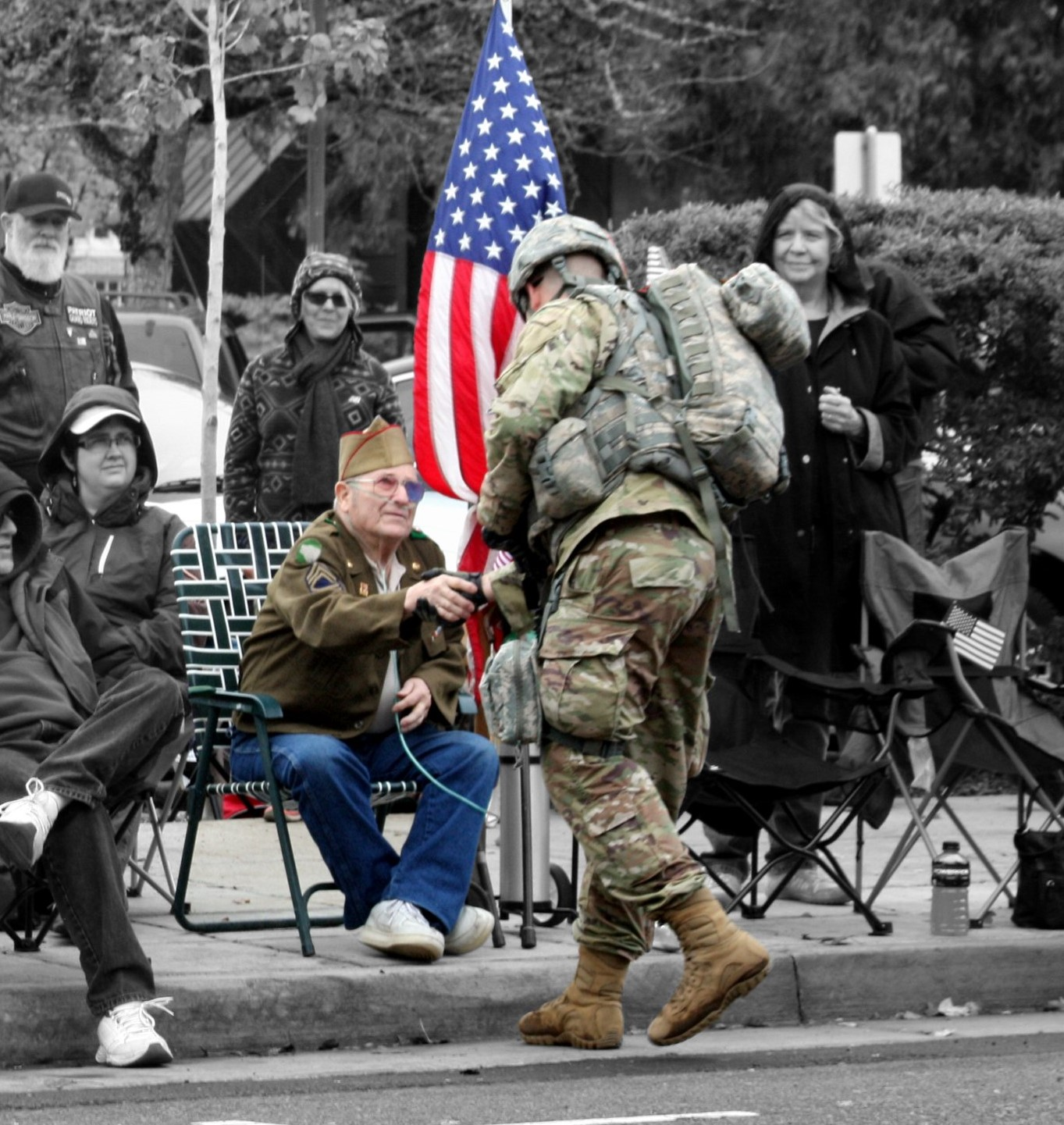 Photo of two veterans greeting each other.