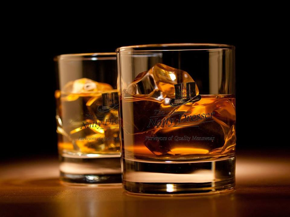 Photo of two glasses with liquor.