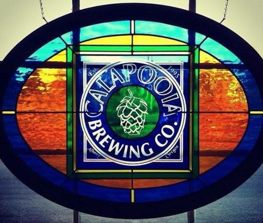 "Photo of stained glass with ""Calapooia Brewing Co."""