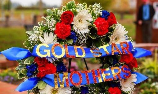 """Photo of flower wreath with banner reading """"Gold Star Mothers."""""""