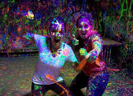 Photo of women covered in paint