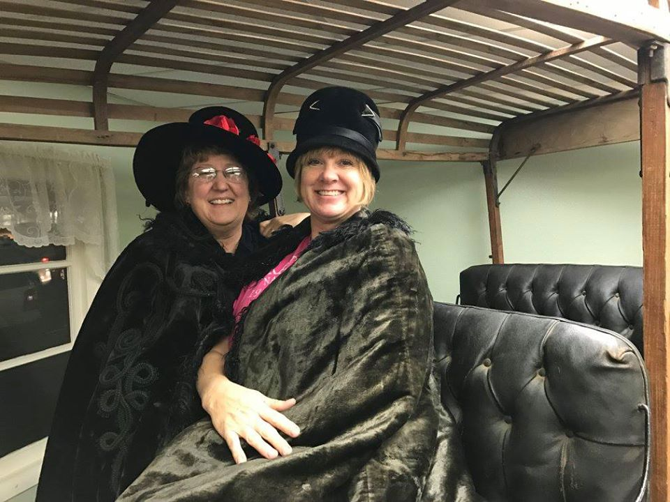 Phot of two women in vintage clothing.