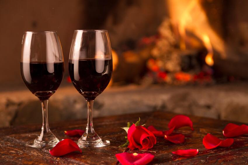 Photo of wine glasses and roses