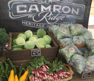 Photo of a farm stand with vegetables at the Albany Farmers' Market