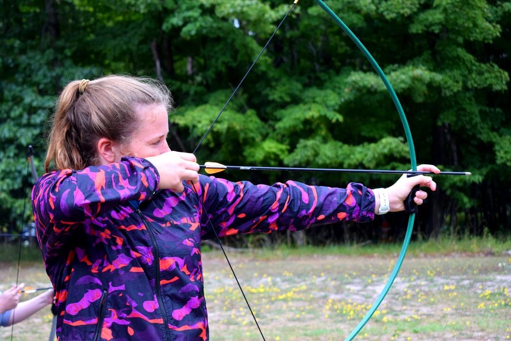 Photo of girl shooting bow.