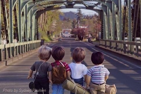 photo of dolls on bridge