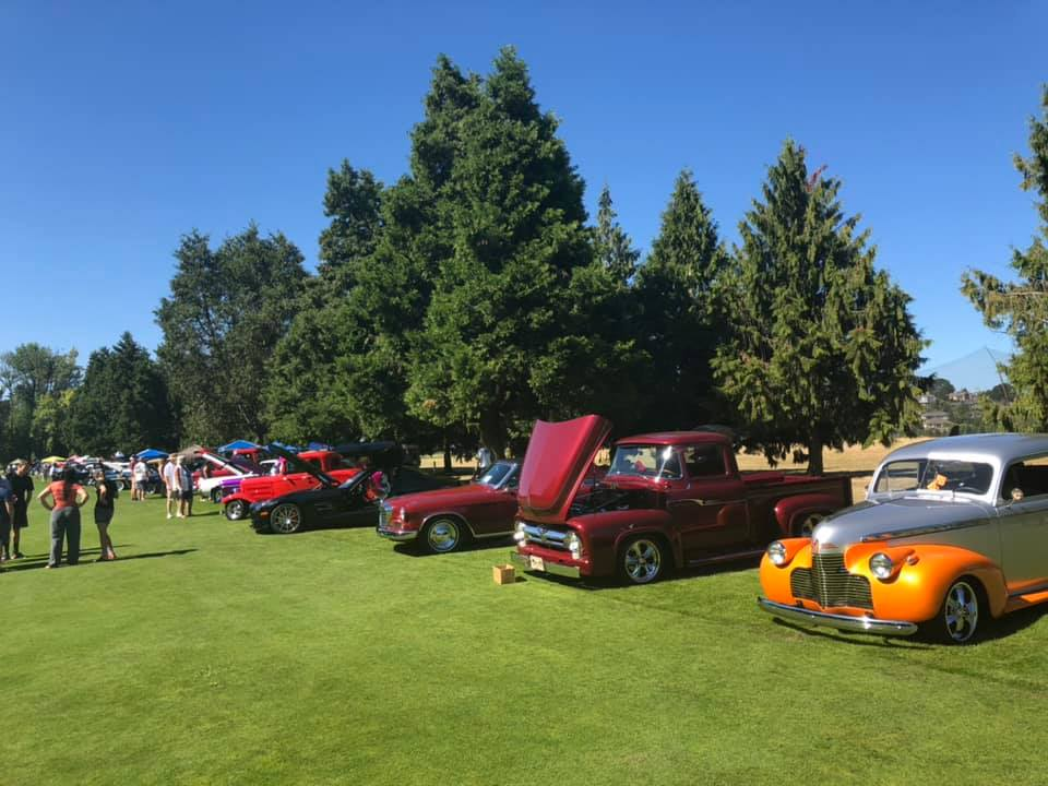 Photo of vintage cars on grass.