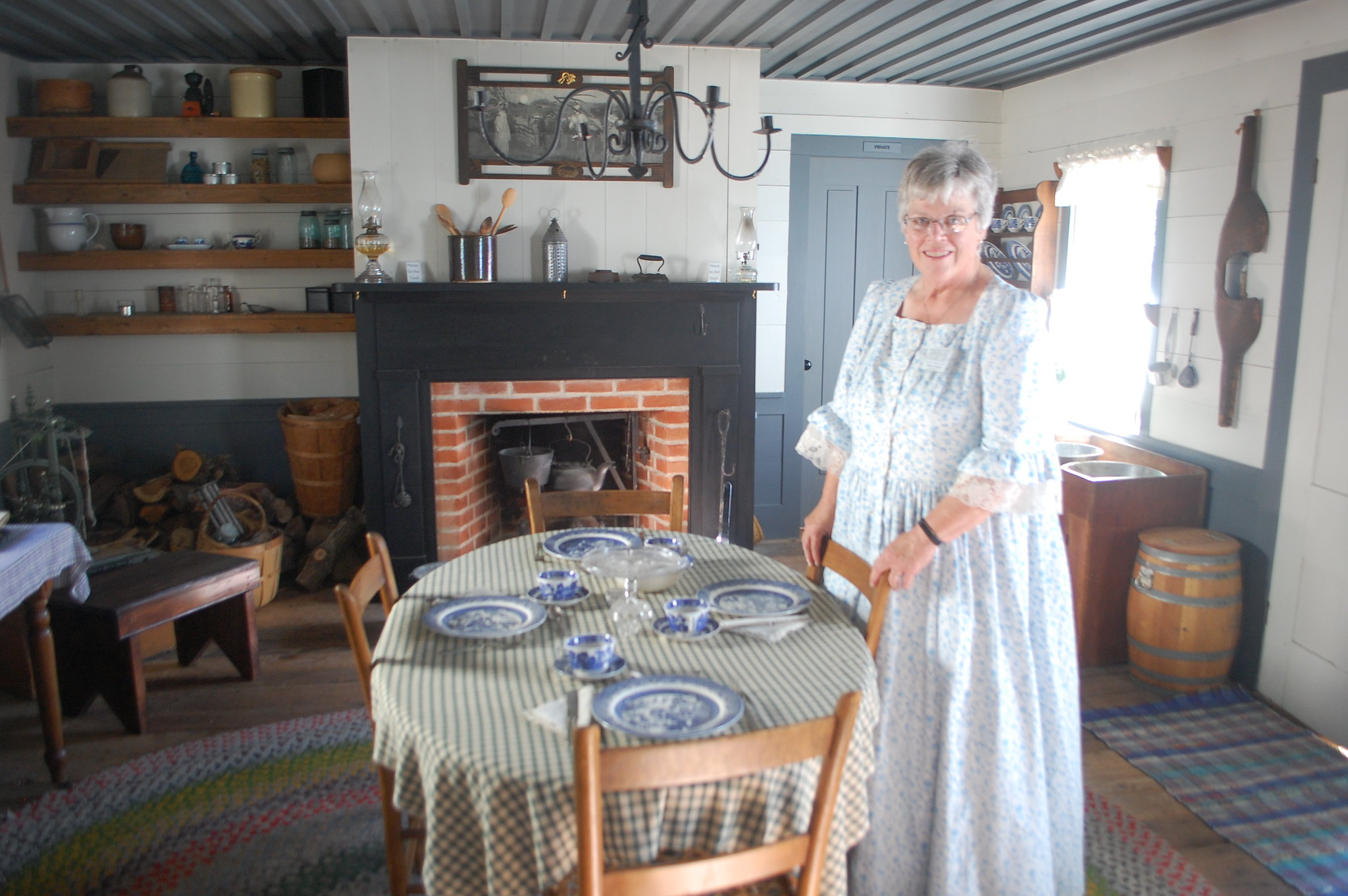 woman in costume in historic house