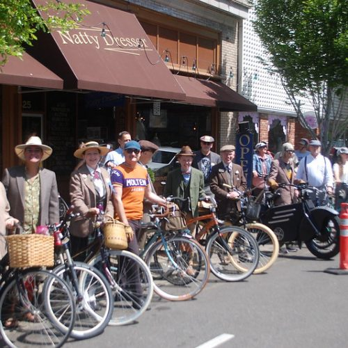 Photo of cyclists dressed in tweed.
