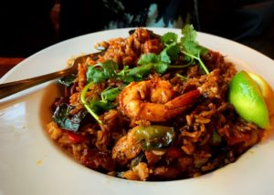 Photo of food, jambalaya, on a white plate at Frankie's Restaurant in Albany, Oregon