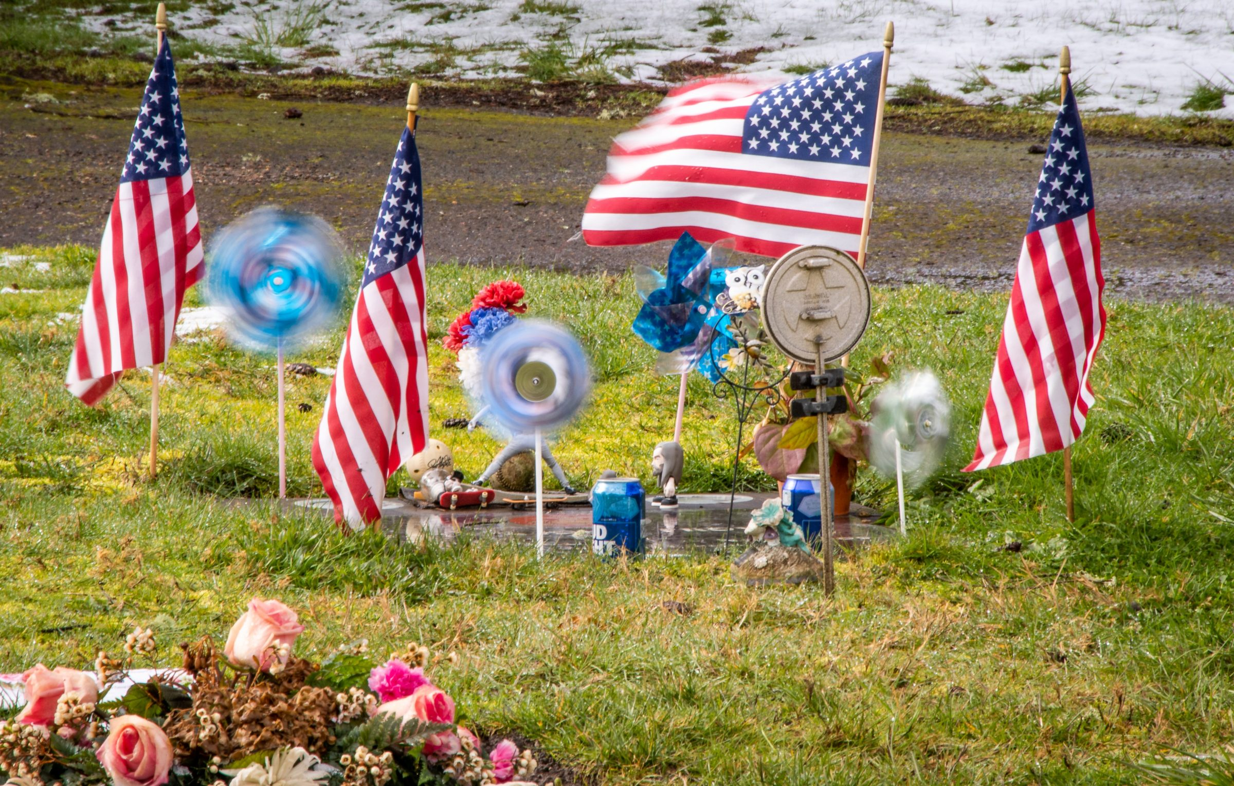 Photo of U.S. flags at grave