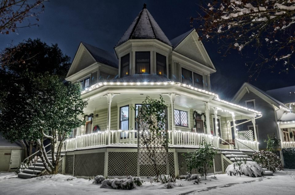 Photo of historic house with lights.