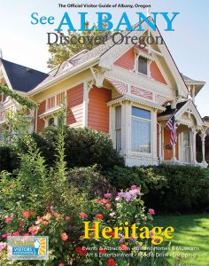 Photograph of the 2019/2020 Albany Visitors Guide magazine cover, featuring a historic home in Albany, Oregon