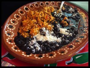 Photo of a plate of Mexican black beans and rice.