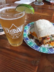 Photo of a craft beer and a taco