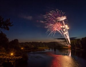 Photo of a fireworks display over the Willamette River on the Fourth of July in Albany, Oregon