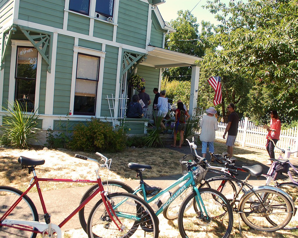 Image of historic home tour with vintage bicycles parked in front