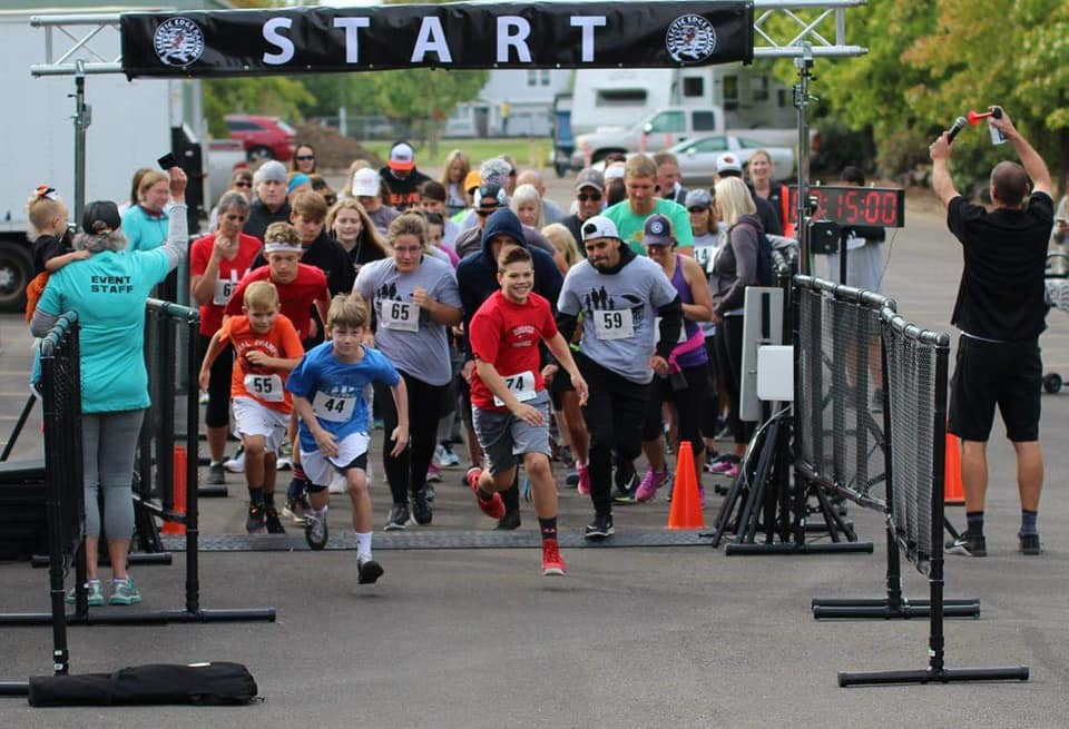 Photo showing people of all ages at the starting line of the marathon at Millersburg, Oregon, annual celebration