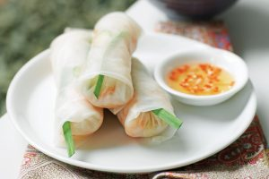 Photo of Vietnamese style spring rolls on a plate with sweet chili dipping sauce