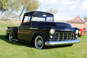 Photo of a black 1956 Chevrolet pickup truck