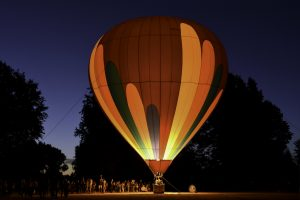 Photo of hot air balloon at the NW Art & Air Festival lit at nighttime