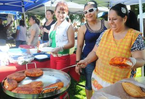 Photo of Albany Oregon Festival Latino featuring cooks making traditional Mexican food on the grill.