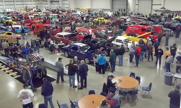 Photo of people and cars at show.