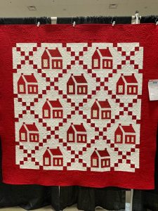 Photo of a red and white quilt at the Willamette Valley Quilt Show