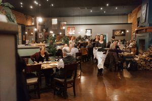 Photo of the interior of Sybaris Bistro and patrons enjoying dinner in Albany Oregon