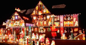 Photograph of a house and front yard decorated with hundreds of Christmas decorations and lights