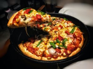 Photo of a hot pizza being served