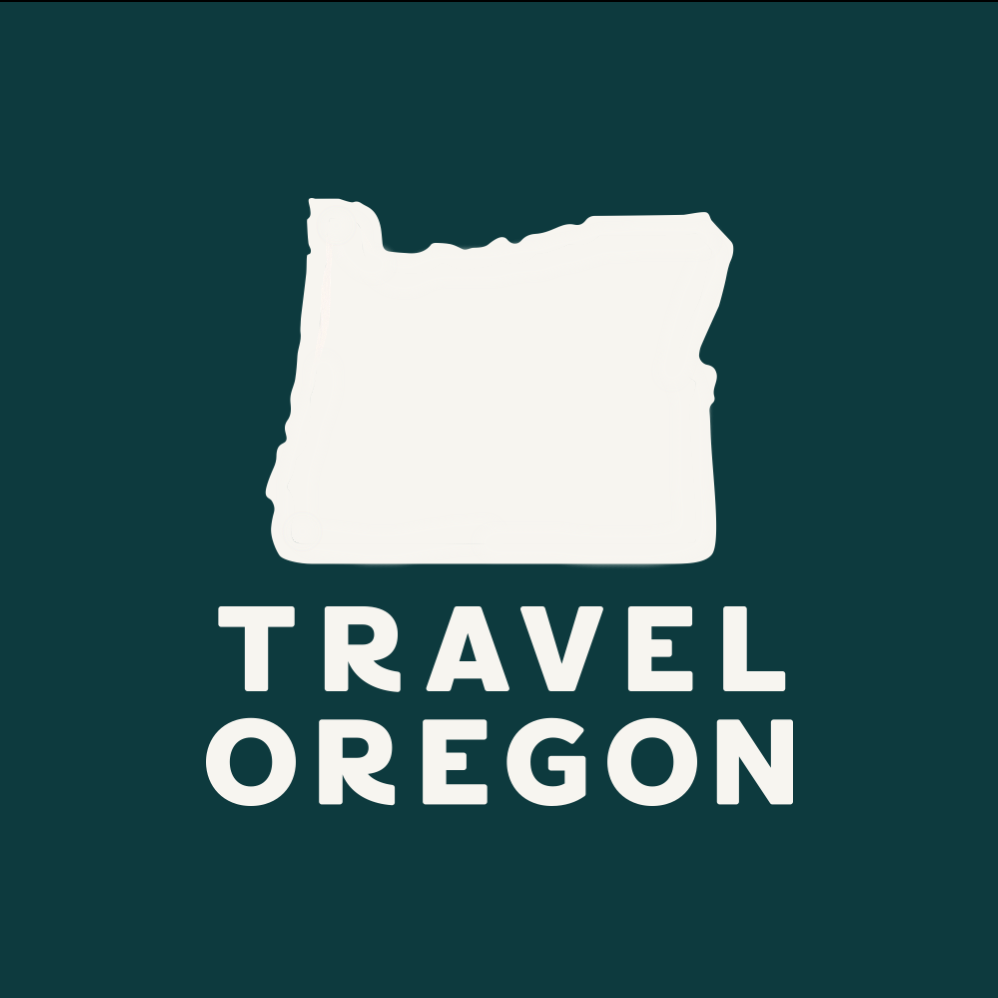 "Travel Oregon logo - a white shape of Oregon with white block lettering saying ""Travel Oregon"" on a deep green background"