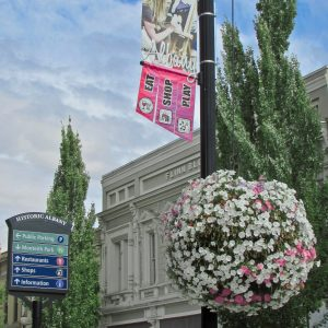 Photo of street in Historic Downtown Albany, OR. with flowers.
