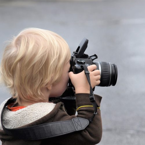 Photo of child taking photograph