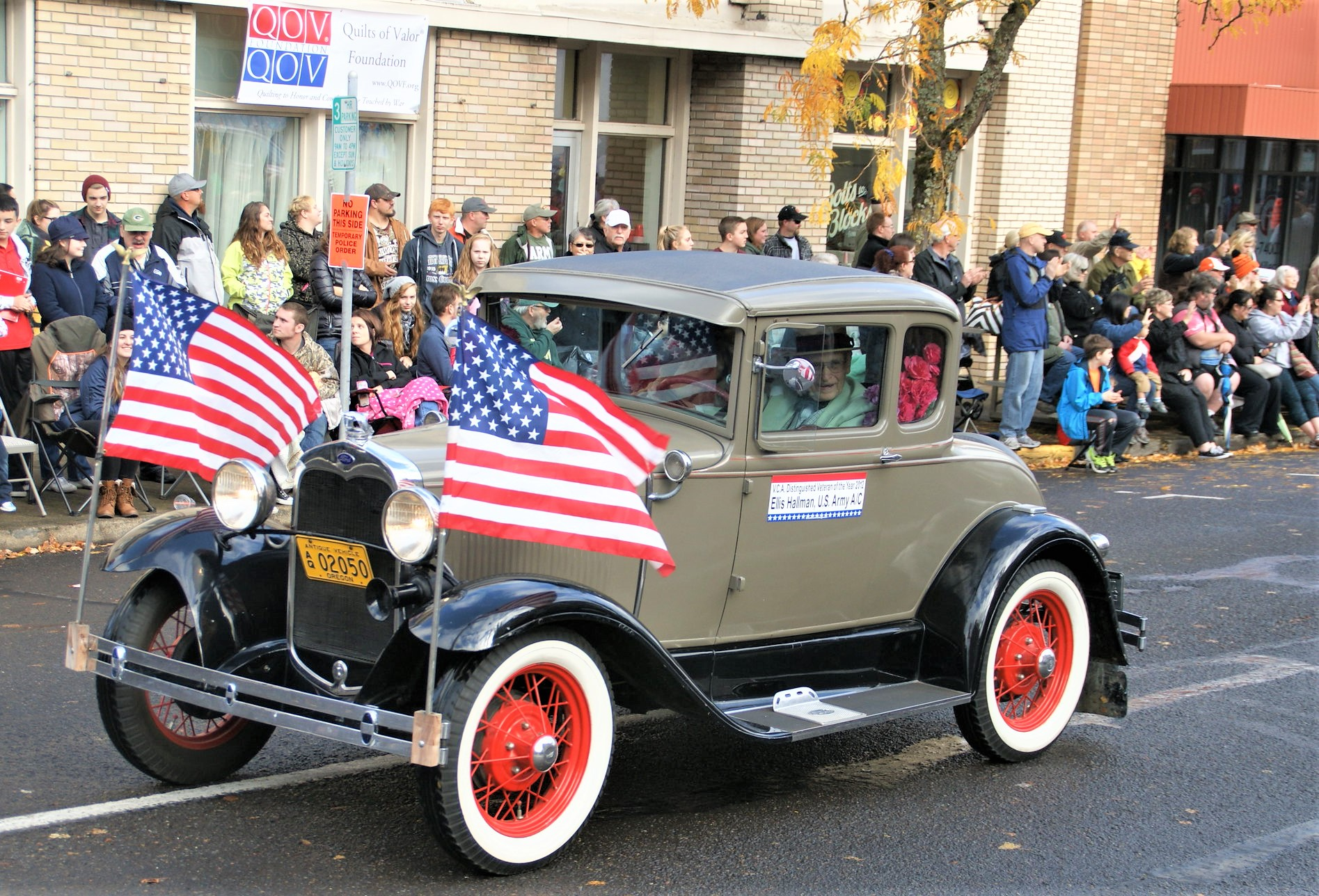 photo of vintage car with US Flags in Veterans Day Parade, Albany, Oregon