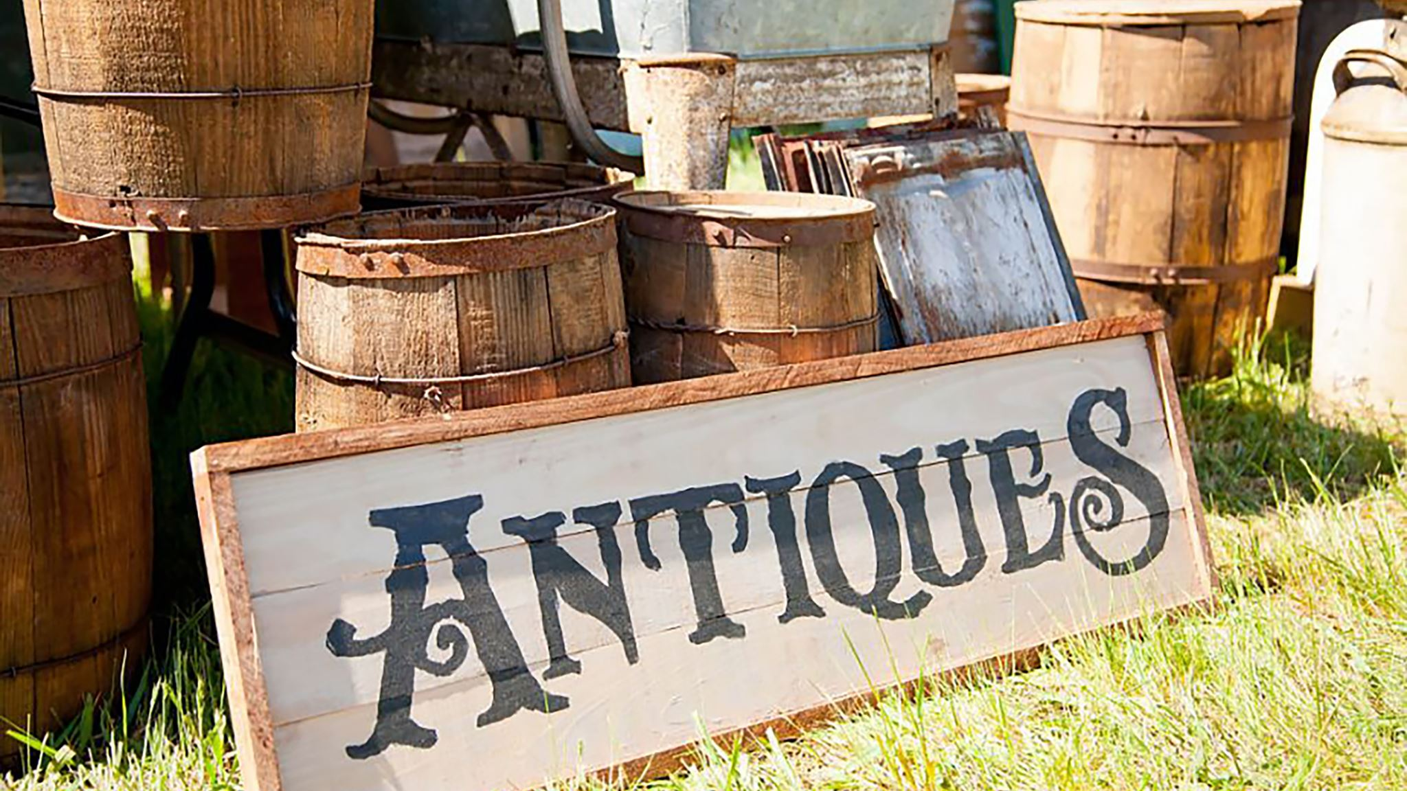 """photo of sign that reads """"Antiques"""""""