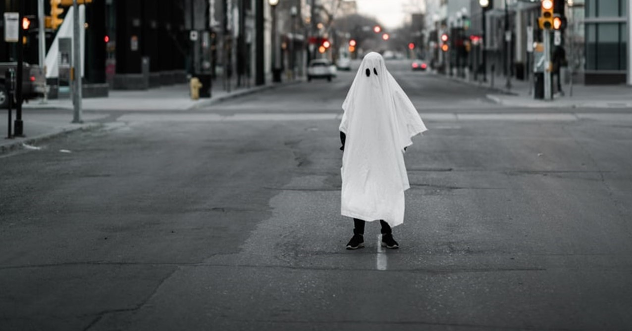 photo of person dressed as ghost on city street